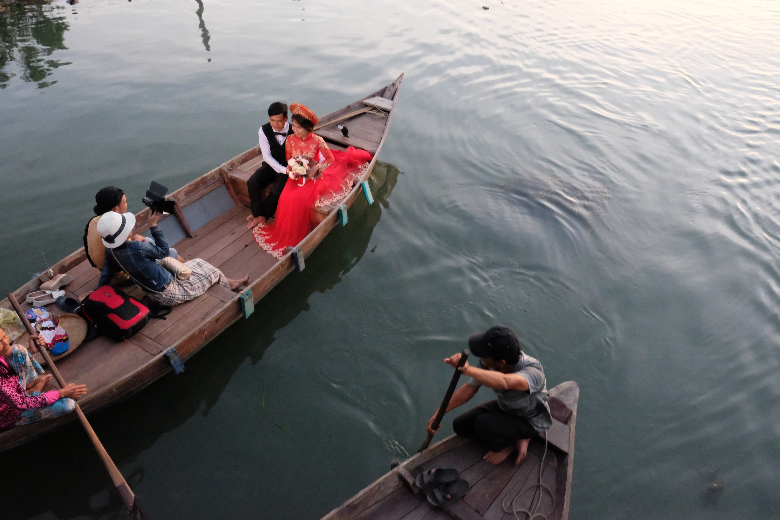 Hoi An, newlyweds on the river.