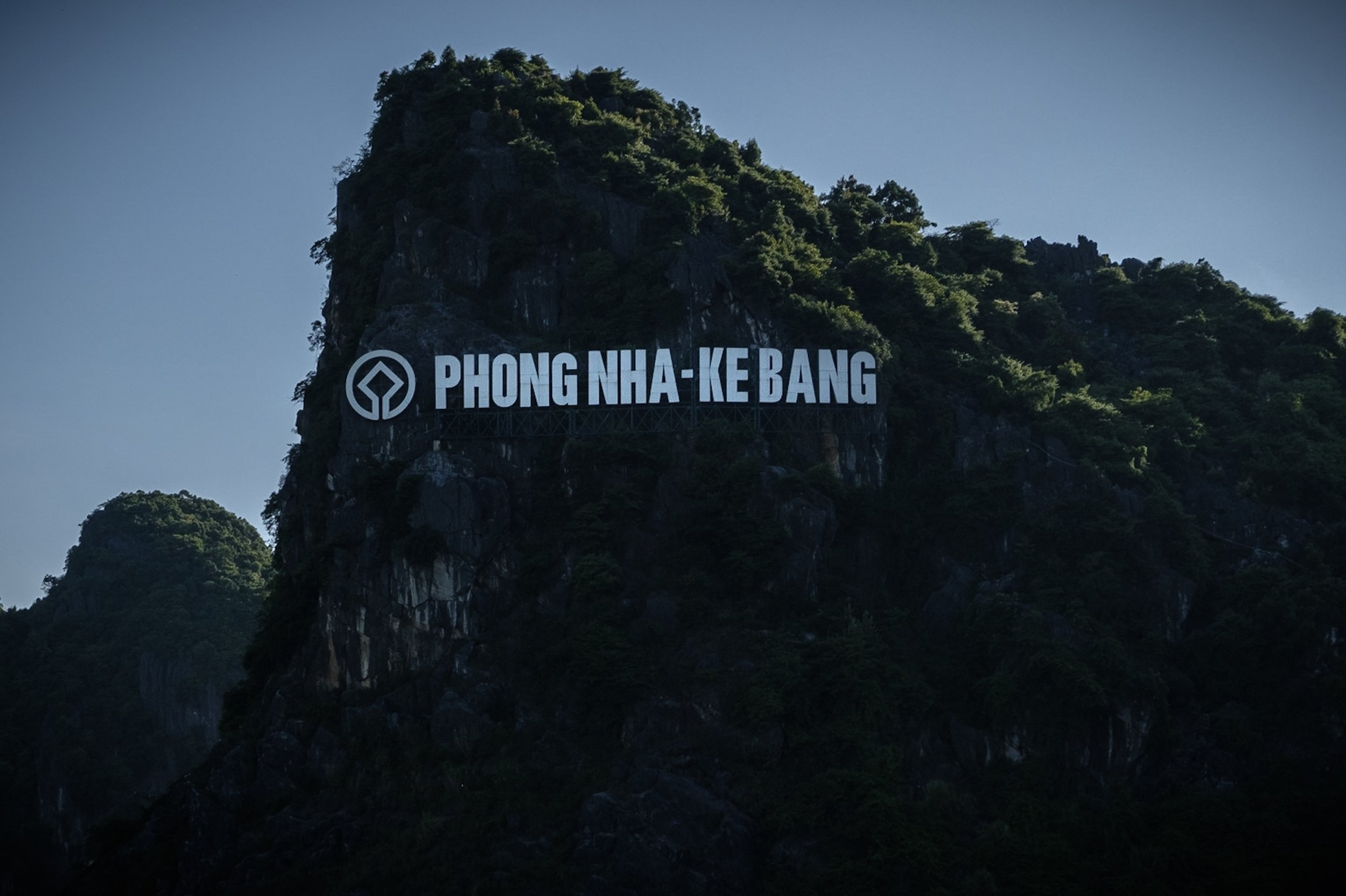 G: Arrival in Phong Nha-Ke Bang, clearly marked with an enormous LED-sign on a mountain.