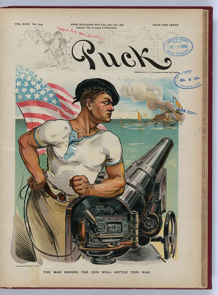 "Cover of Puck, July 13, 1898. An American sailor wearing a cap labeled ""U.S. Navy"", leaning on a ship cannon, with an American flag behind his right shoulder and the ruins of the Spanish fleet in the background. Library of Congress Prints and Photographs Division"