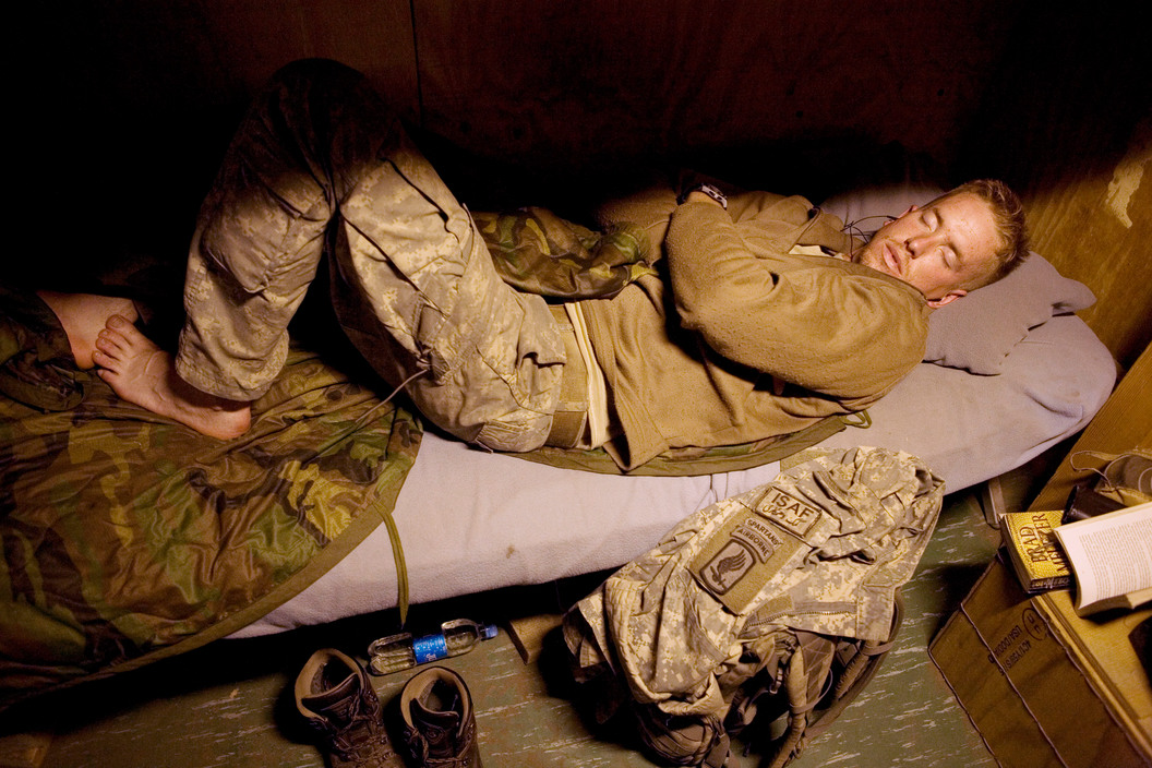 Specialist Luke Nevala sleeping in Korengal Valley, Kunar Province of Afghanistan. July 2008. Courtesy of the   Tim Hetherington Trust.