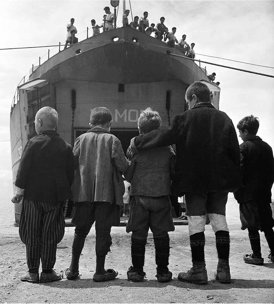 Five boys from Promahi in front of the refugee ship S.S. Samos that evacuated children during the Civil War in Greece. © David Seymour / Magnum Photos