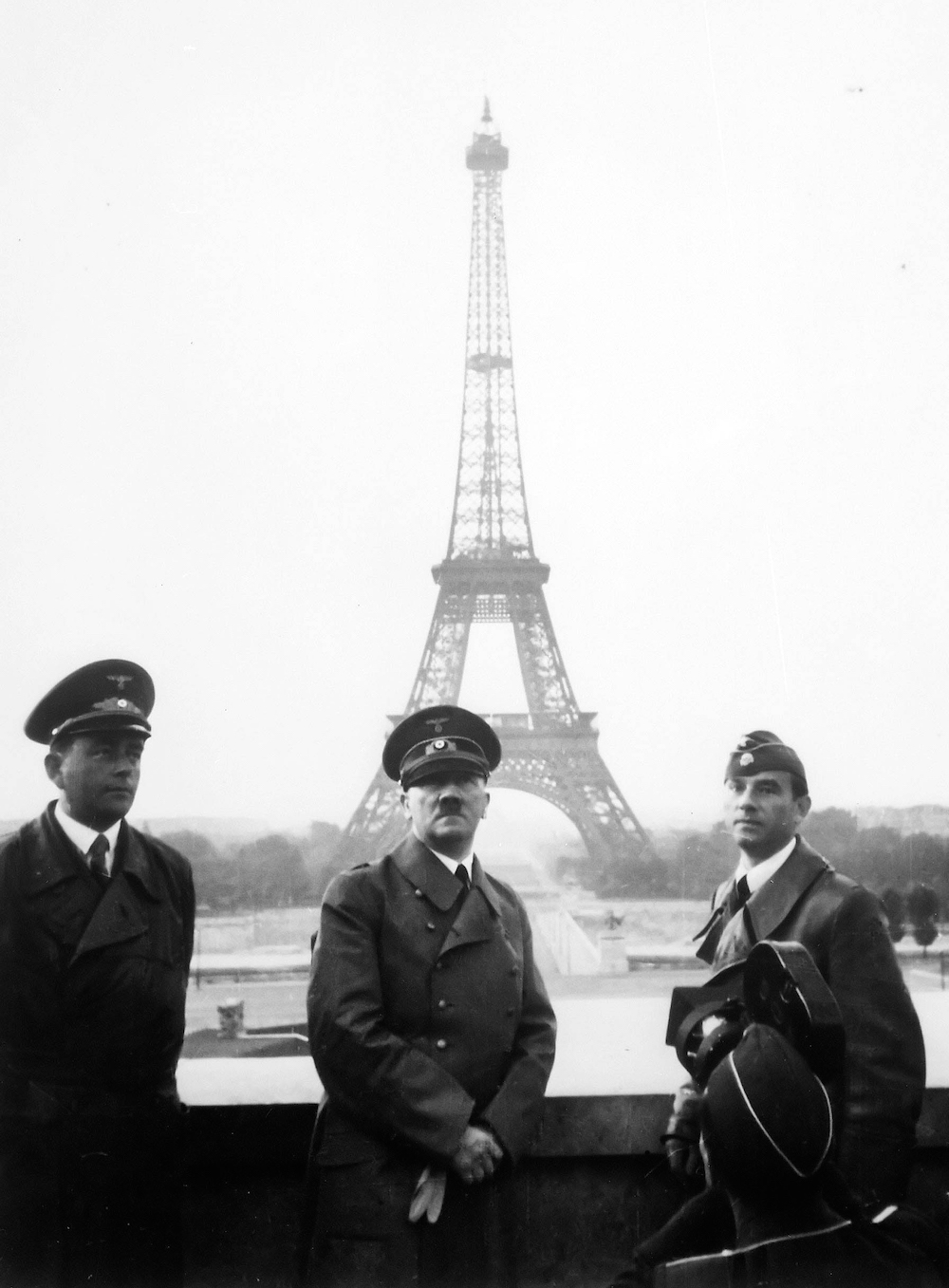 Photograph by Heinrich Hoffmann (seized by the US government after WWII): Adolf Hitler visits Paris with architect Albert Speer (left) and artist Arno Breker (right), June 23, 1940. Courtesy of the  US National Archives.