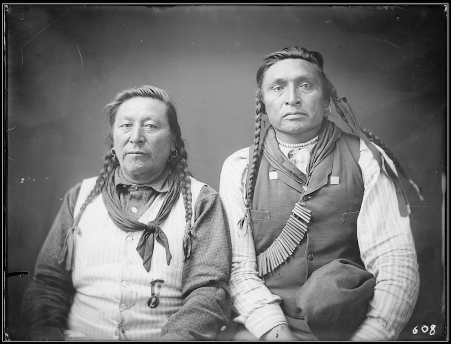 A portrait of Chief Plenty Coups and Bull Snake. Photograph courtesy of the Richard Throssell Collection, American Heritage Center,  University of Wyoming.Original photograph by Throssel Photocraft Company, 6.5x8.5 inch glass plate negative.