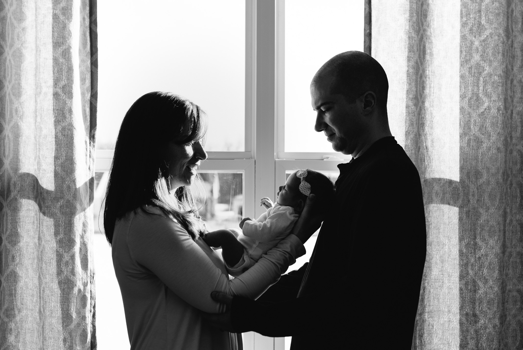 Parents-holding-newborn-baby-girl-Columbus-Ohio-Photographer-Erika-Venci-Photography