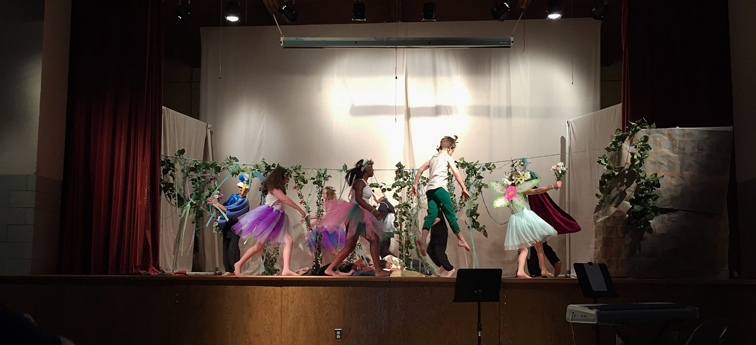 "A scene from ""A Midsummer Night's Dream"" performed by the 5th grade."