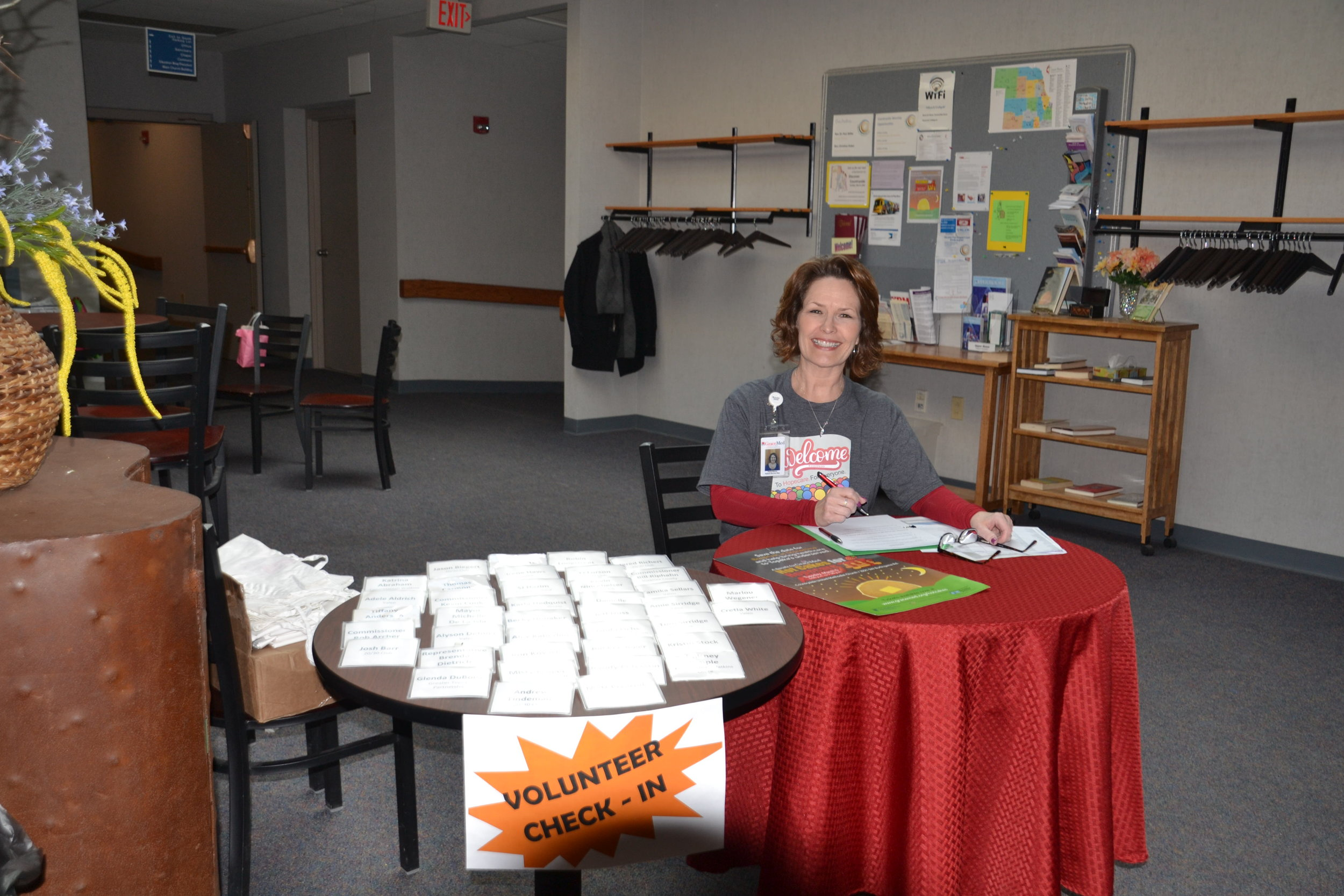 GraceMed's Paula Bacon signs in the volunteers