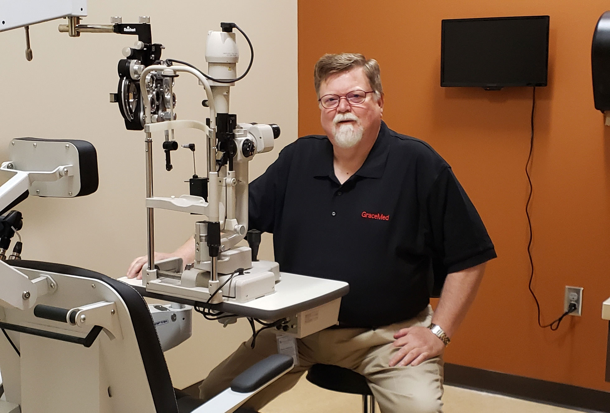 Dr. Mark Judd in an exam room at GraceMed Capitol Family Clinic