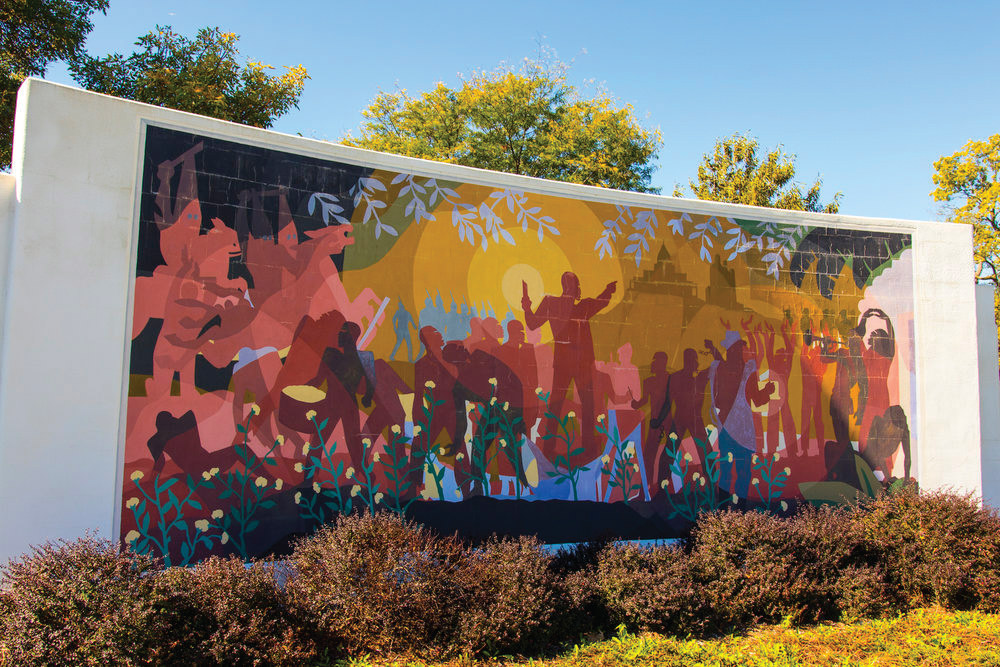 The Aaron Douglas Mural on the campus of nearby Washburn University was the inspiration for the Art Fair of the same name hosted in the park behind Capitol Family. - The annual event has become a passion for GraceMed patient, Joe Cheray.