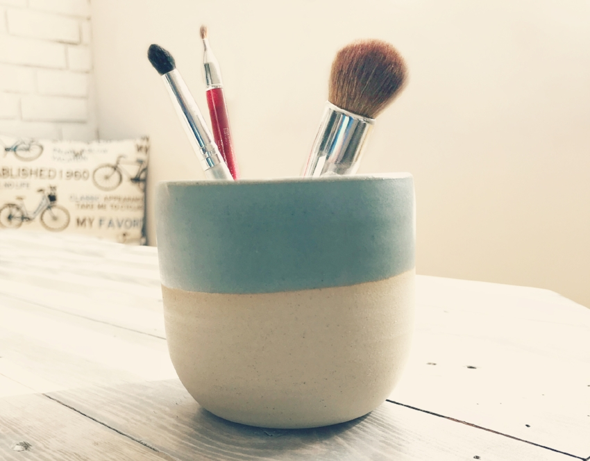 SeaLuxe customer Molly L shows off her makeup brush holder/cleaning bowl. Molly said she loved the ceramic candle holder so much, she repurposed it after using up the eco-soy West Coast-scented candle.