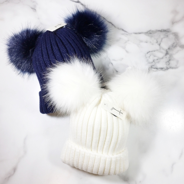Shown above White & Navy Double Fur Pom Knit Hat! Available at BTHB In-Store & Online!