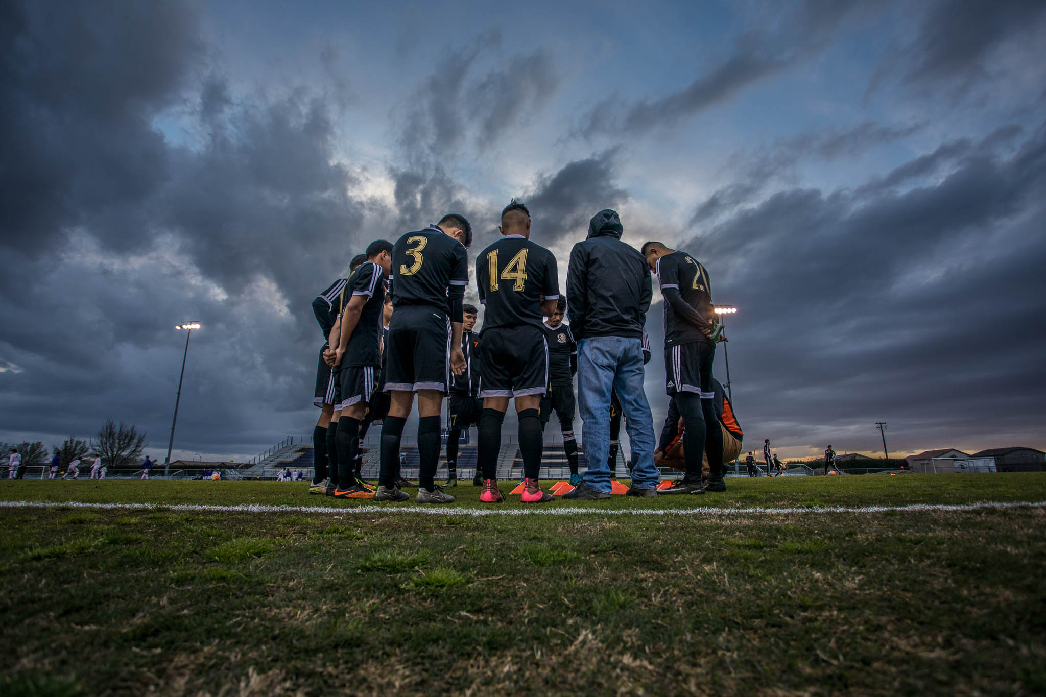 The Varsity Boys Soccer team huddles right before the start of the game.