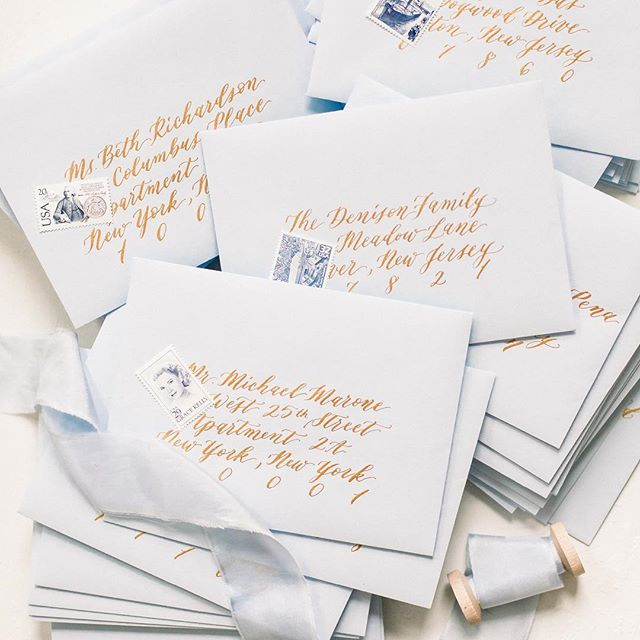 Stacks of pale blue with gold calligraphy are getting prepped for shipping! ✨