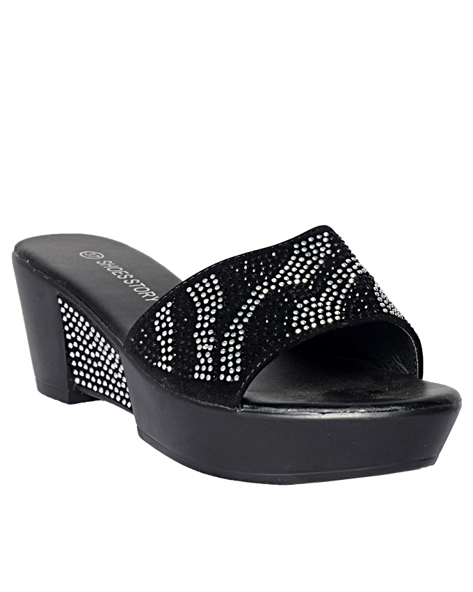 leather slippers with studded top - black    sizes  u.k 6  n10,500