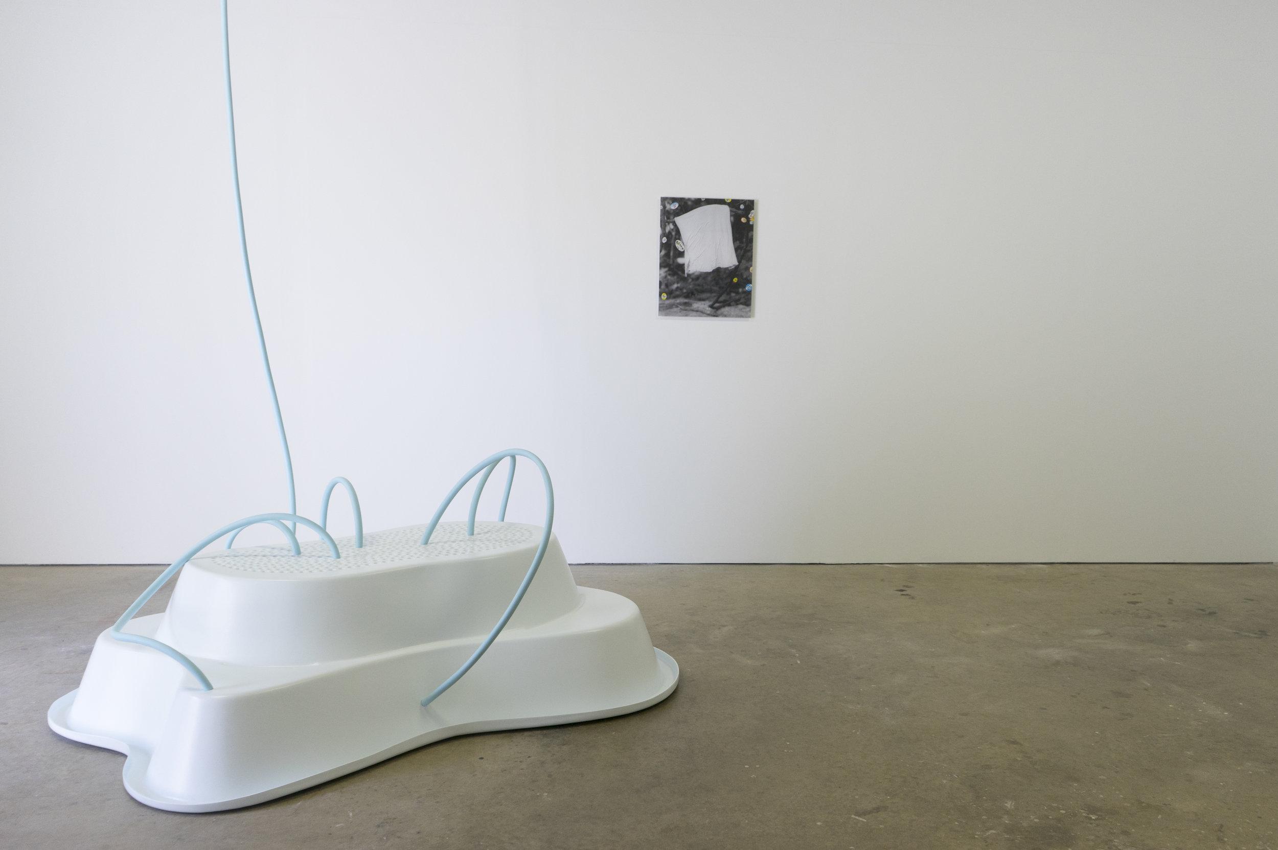 Jess Machacek   OCEANUS:OURANOS   2017  preformed pond, latex paint, garden hose  &  David King   Untitled   2015  pigment print on plexiglass and produce stickers