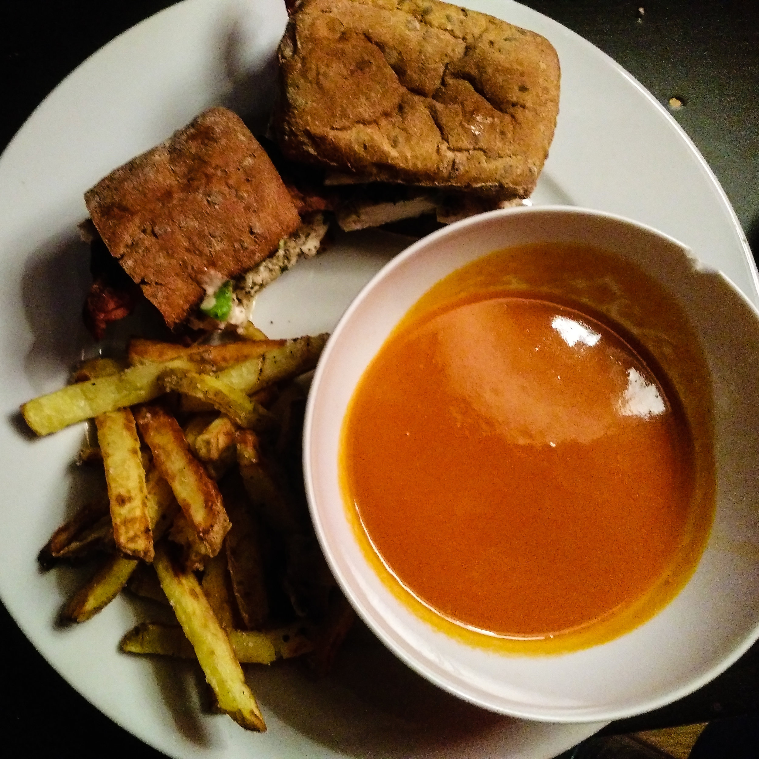 Fantastic dinner of chicken, avocado, bacon sandwich on gluten-free bread with a chipotle mayo. Side of homemade oven cooked fries and a organic tomato soup (which I was too full to eat).