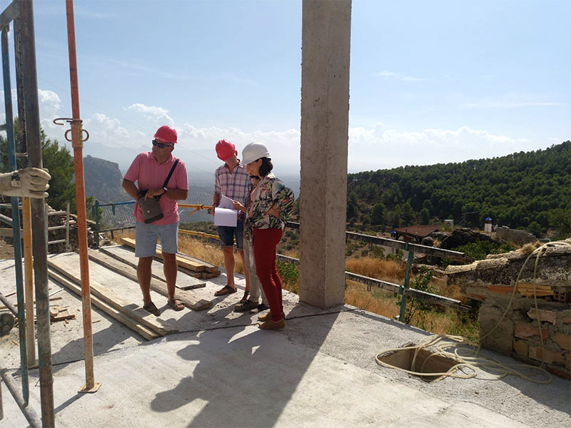 Looking glamorous in our hard hats, standing on the terrace