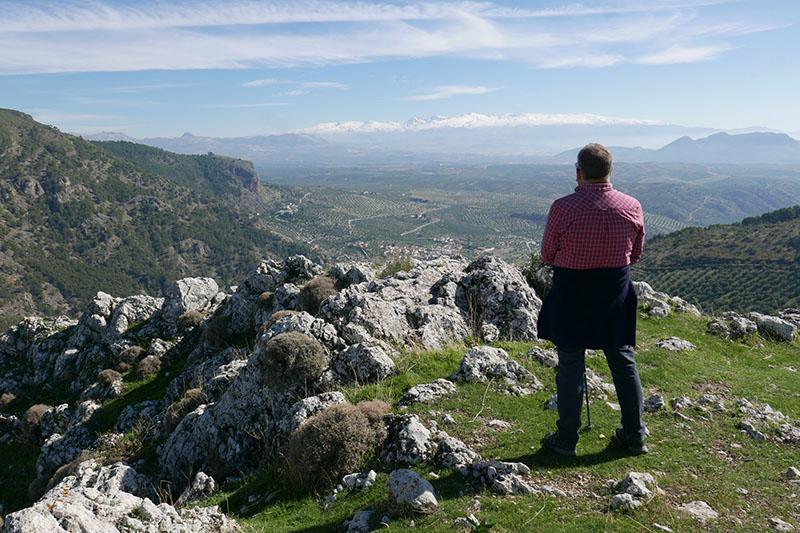 Taking in the view over Los Olivares, Vega de Granada and the snow capped Sierra Nevada