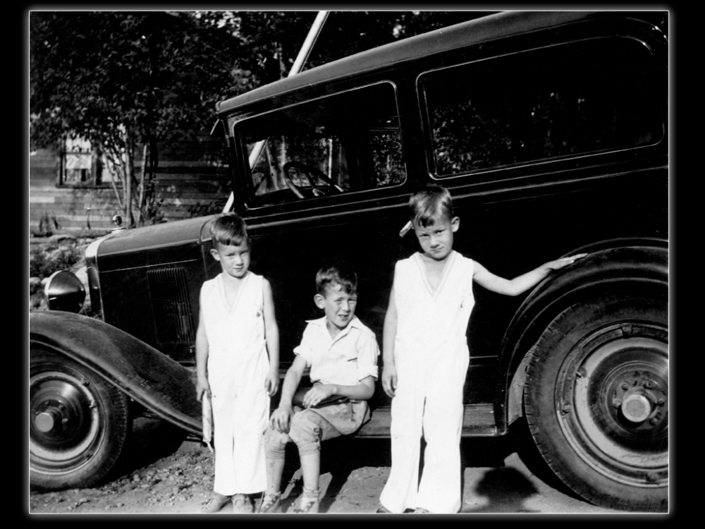 Lou, Barney and Jim with a neighbor's car, about 1935.  Whittaker Family Collection