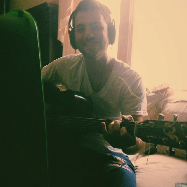 Derek recording acoustic guitar for Sera Feliz at the John Wilkes Recording booth. Also 3 shows this week!