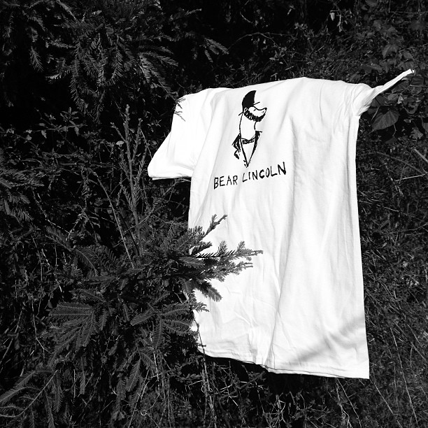 Does a bear shirt in the woods? Limited quantities available. Get yours tonight at the Ivy Room.