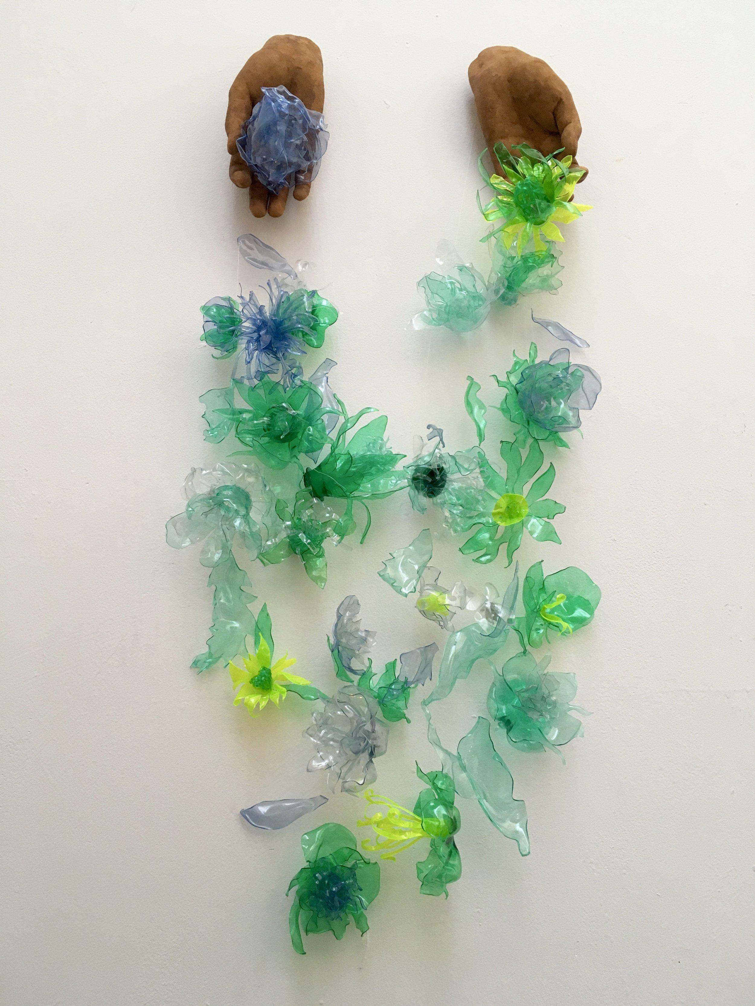 Detritus  (Recycled bottles, bio resin, fishing line) 25cm by 80cm