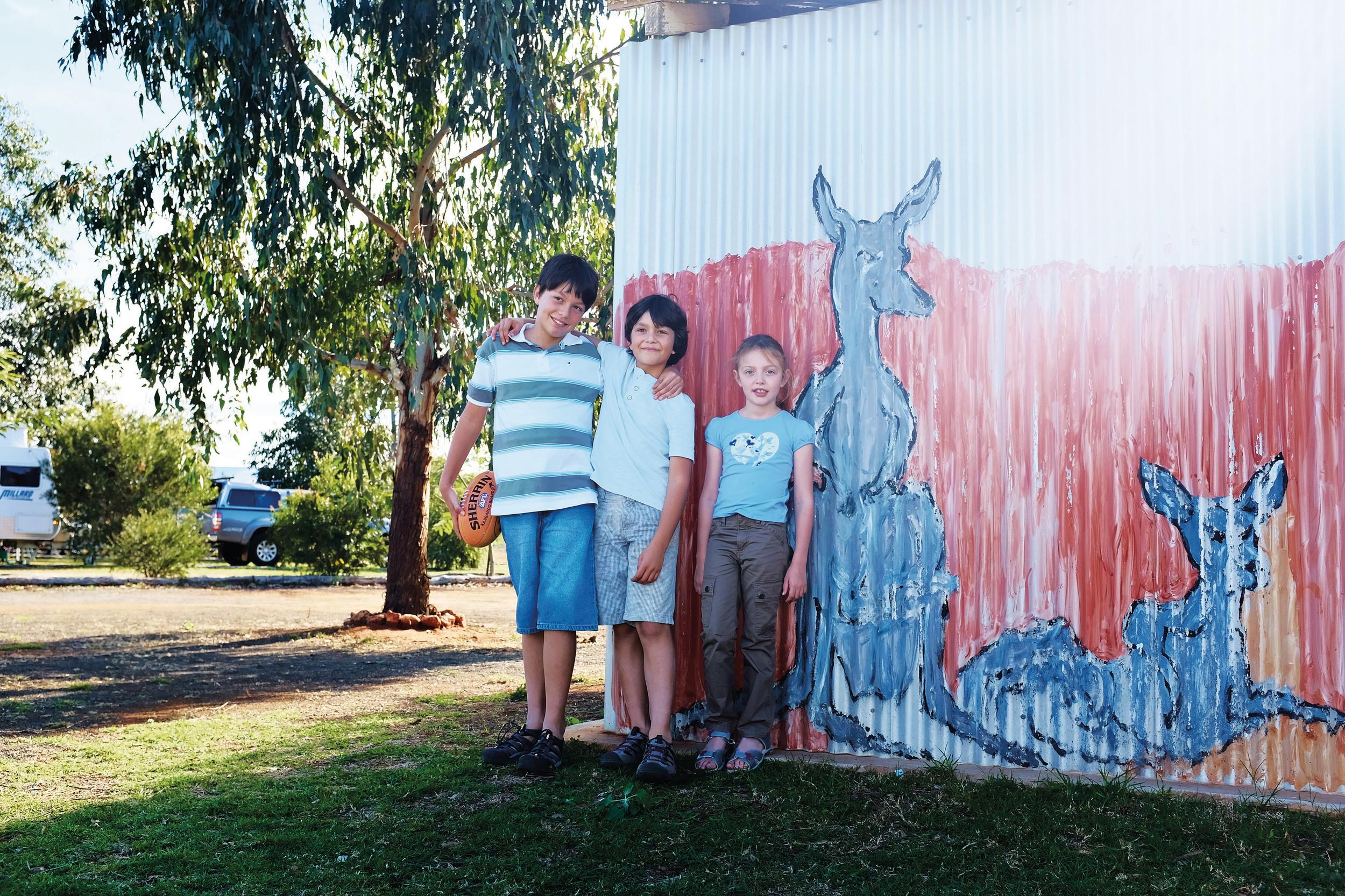 Charleville - Kids standing next to artwork on a shed.jpg