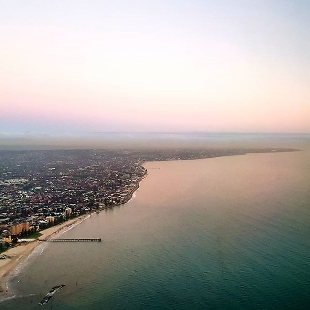 Farewelling South Australia for the week.  Our Senior Lawyer Kai took off at sunrise for the Torres Strait and our Principal Michael took off at sunset for Western Australia's mid-west, both to attend meetings with Traditional Owners.  Photo is of Glenelg to Adelaide's southern coastline, Kaurna land.