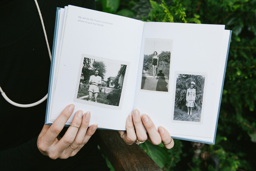 Kelsey with book  Girls Standing on Lawns by Maira Kalman