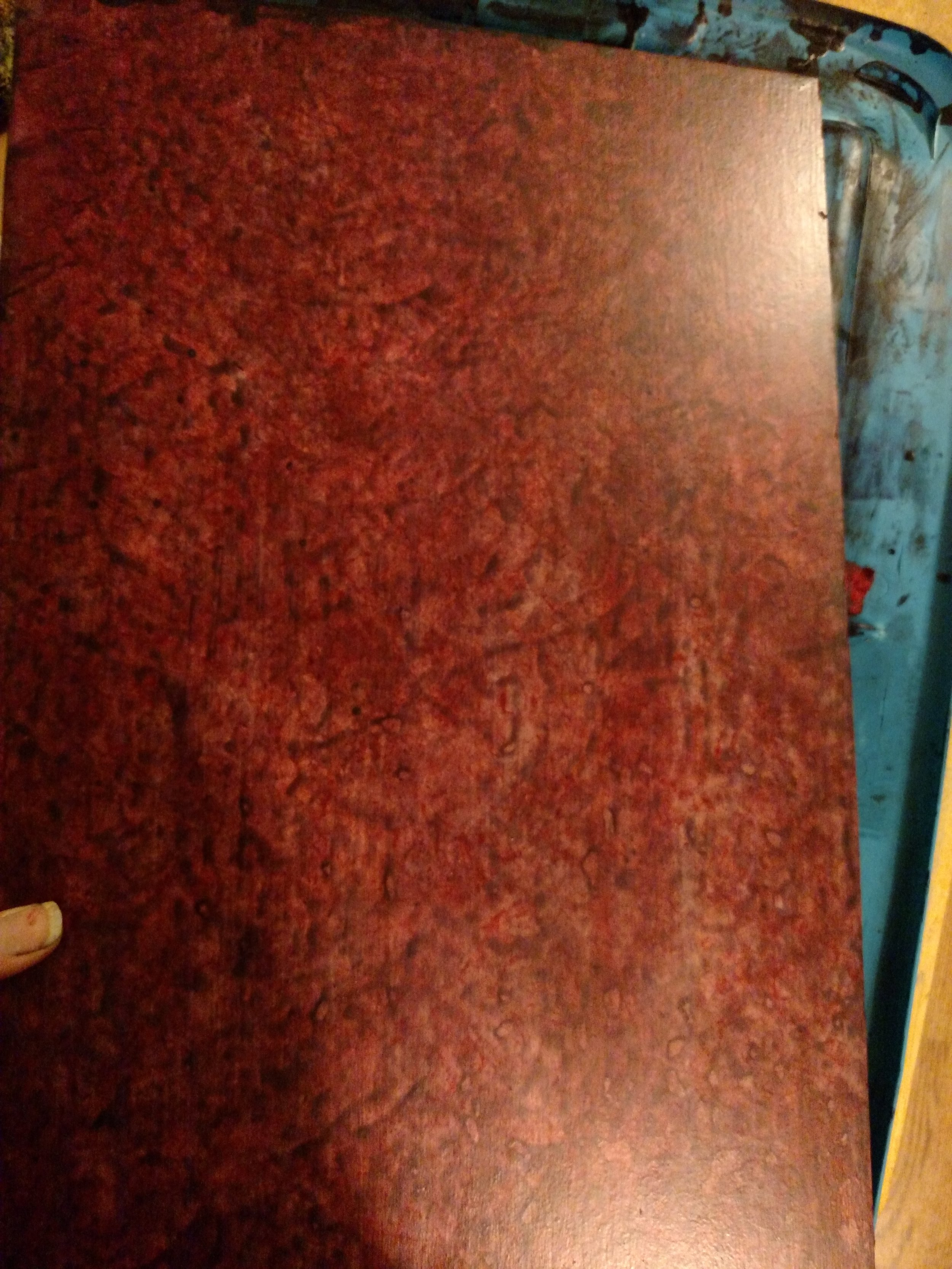 Gave the blood splatter pattern a red glaze to pull it all together. One last sanding and then a clear top coat.