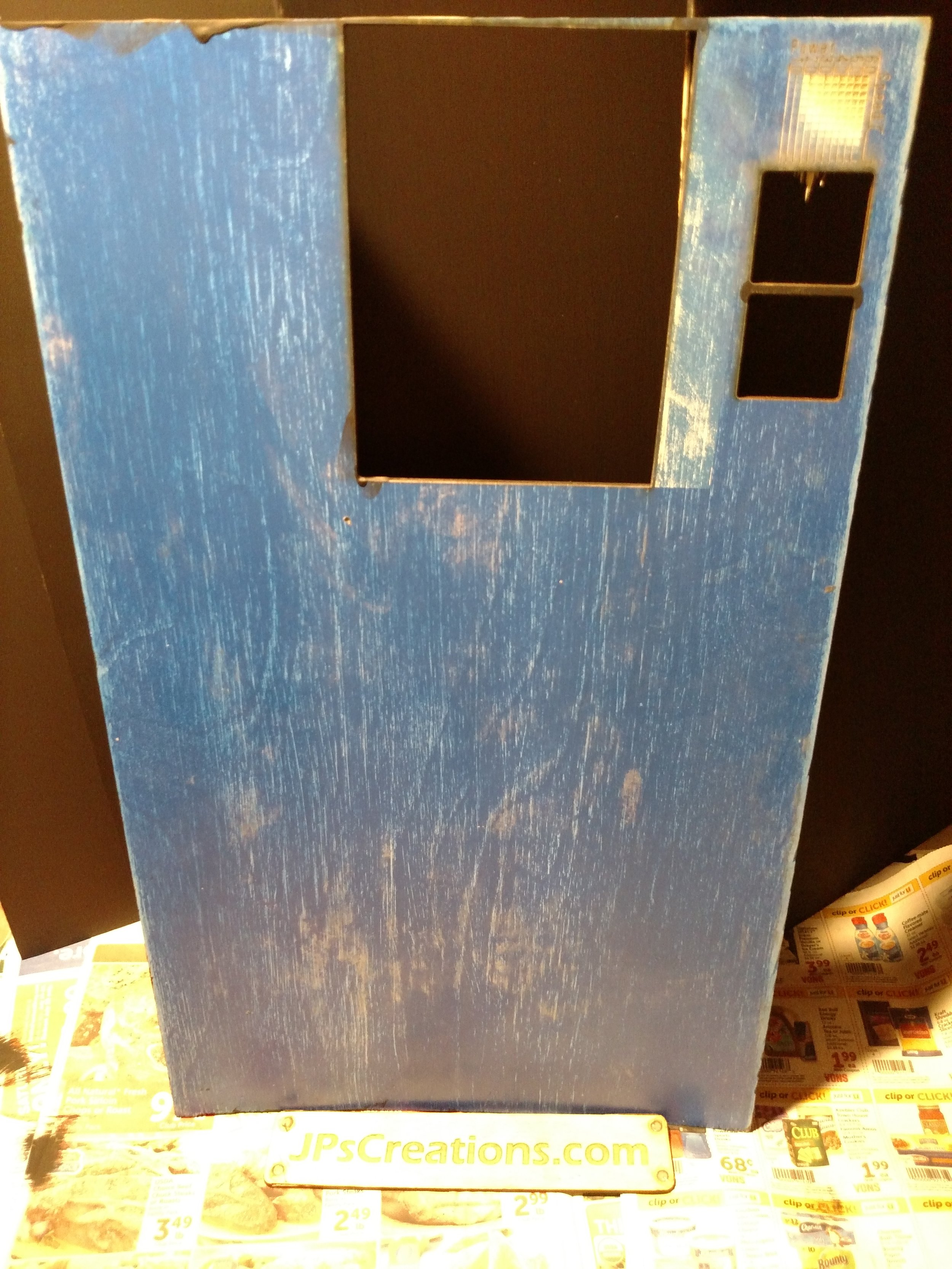 Gesso that was painted blue and then sanded to create a white and blue grain effect