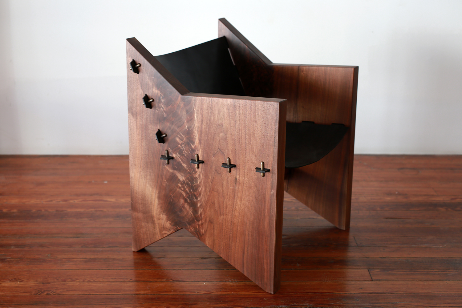 Shown in Black Walnut, with black leather