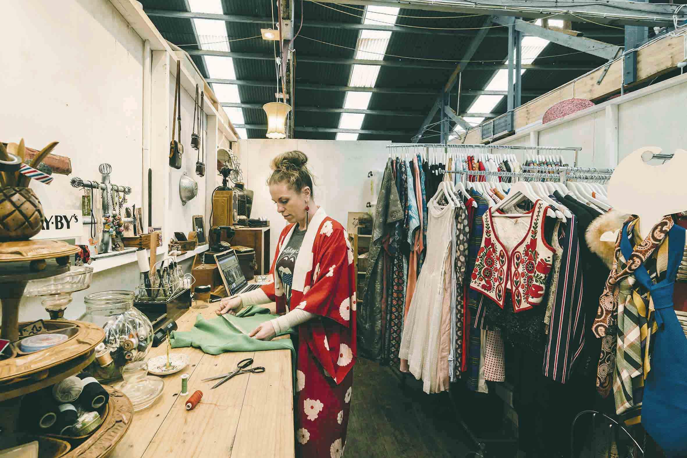 Minette's Vintage preparing her vintage wares in her studio at Nauti.jpg