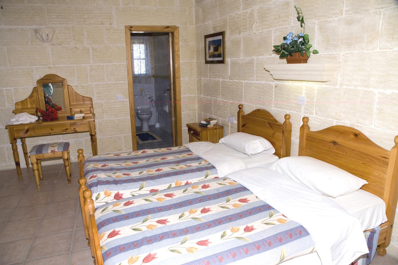 First single bedroom with en-suite shower bathroom