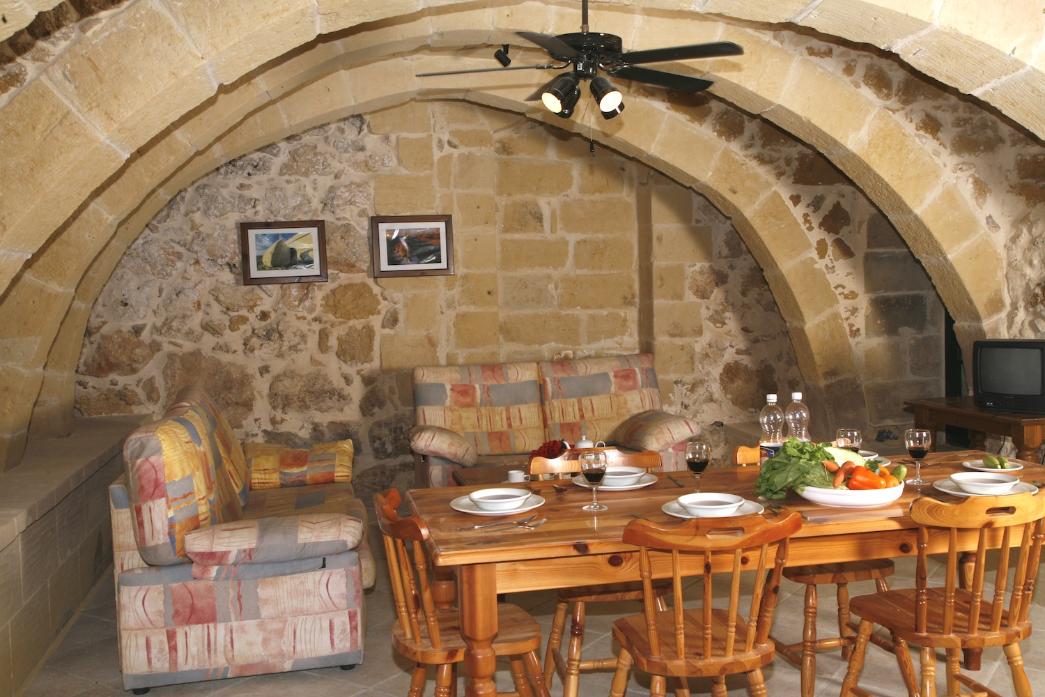 Living and dining area underneath original arches
