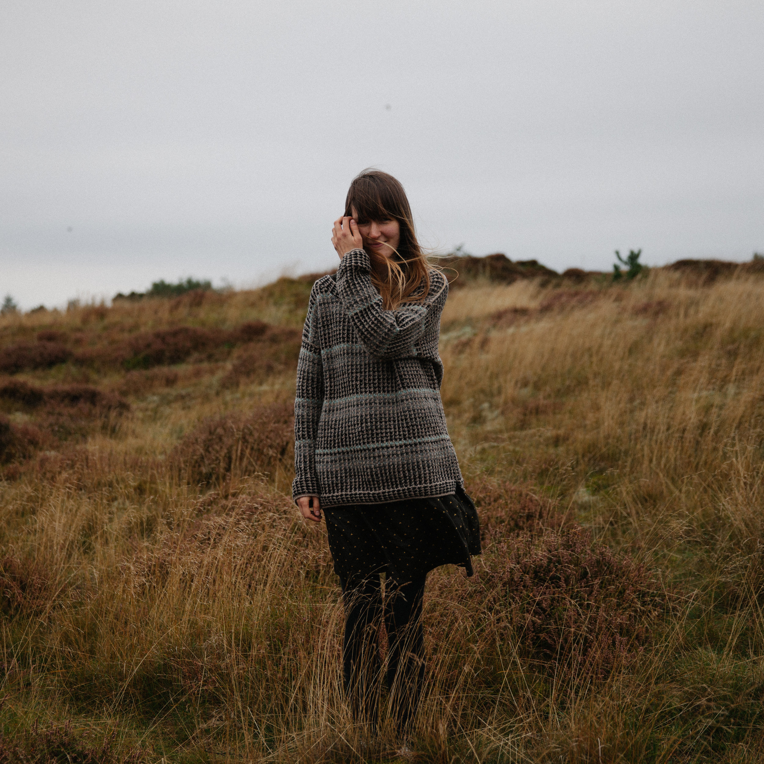 Caroline wears a Biches & Bûches colourwork jumper.
