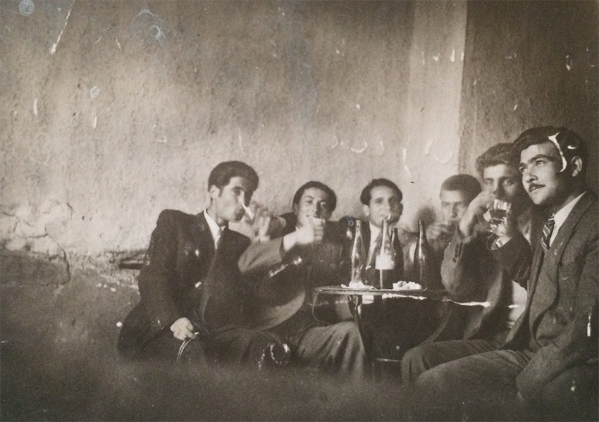 My grandfather drinking wine with friends