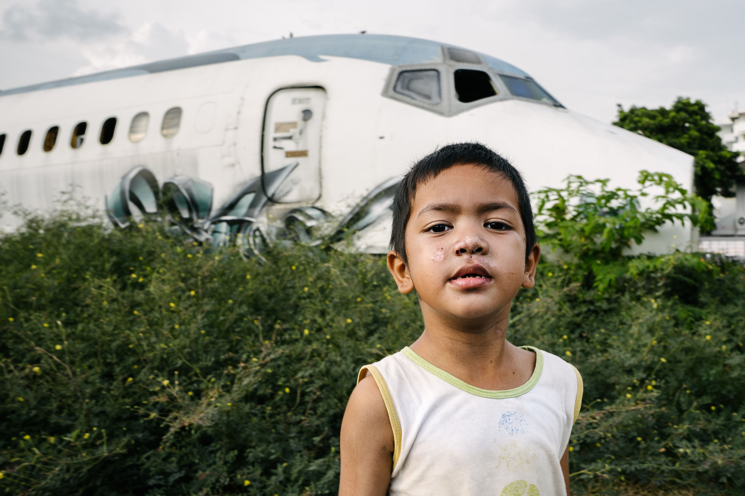 As our population grows the gap between the wealthy and the poor grows with it. This boy found asylum with his and other families in this previously abandoned airplane graveyard. It was an ironic twist of fate that these planes became homes to those who could never have afforded to fly in them.