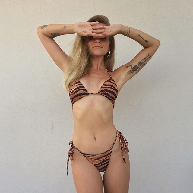 💦💦💦 FEELING THE HEAT?🔥🔥 We know what to wear and @mariejedig knows too ❤️ Buy our TIGER bikini online!