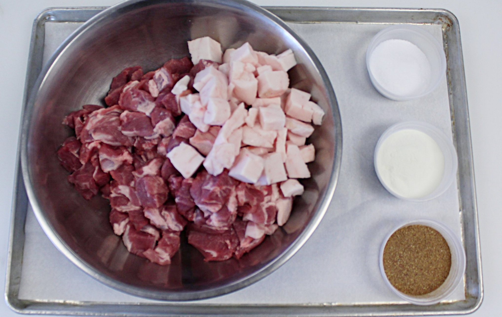 Seasoning:  We prefer to use kosher salt for it's purity and texture, as well as fresh herbs and whole spices in our sausage making.  We will freshly chop or grind the seasoning and add them to the cubed meat a few hours, or up to a day, before grinding.  This will ensure even distribution and enhance the overall flavor of the sausage.  When following the recipe below, feel free to omit of substitute different seasonings to your taste, just ensure the salt to meat ratio remains the same.
