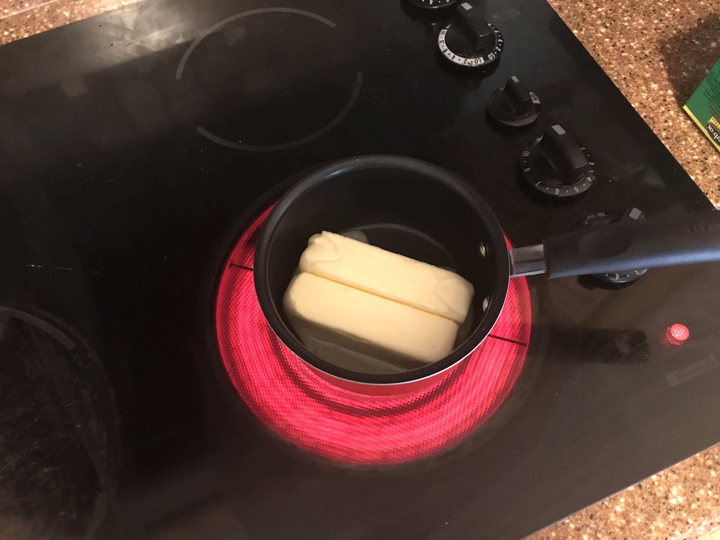 Melt down two sticks of butter over medium-high heat.