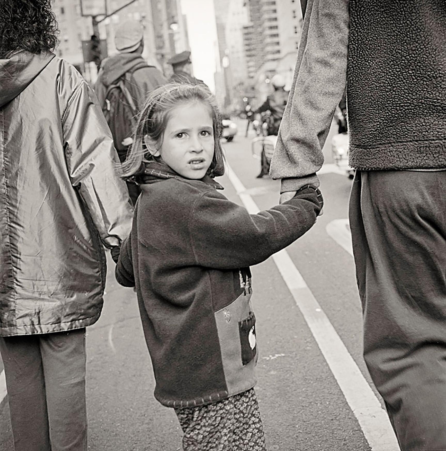 little-girl-walking-up-6th-Avenue.jpg