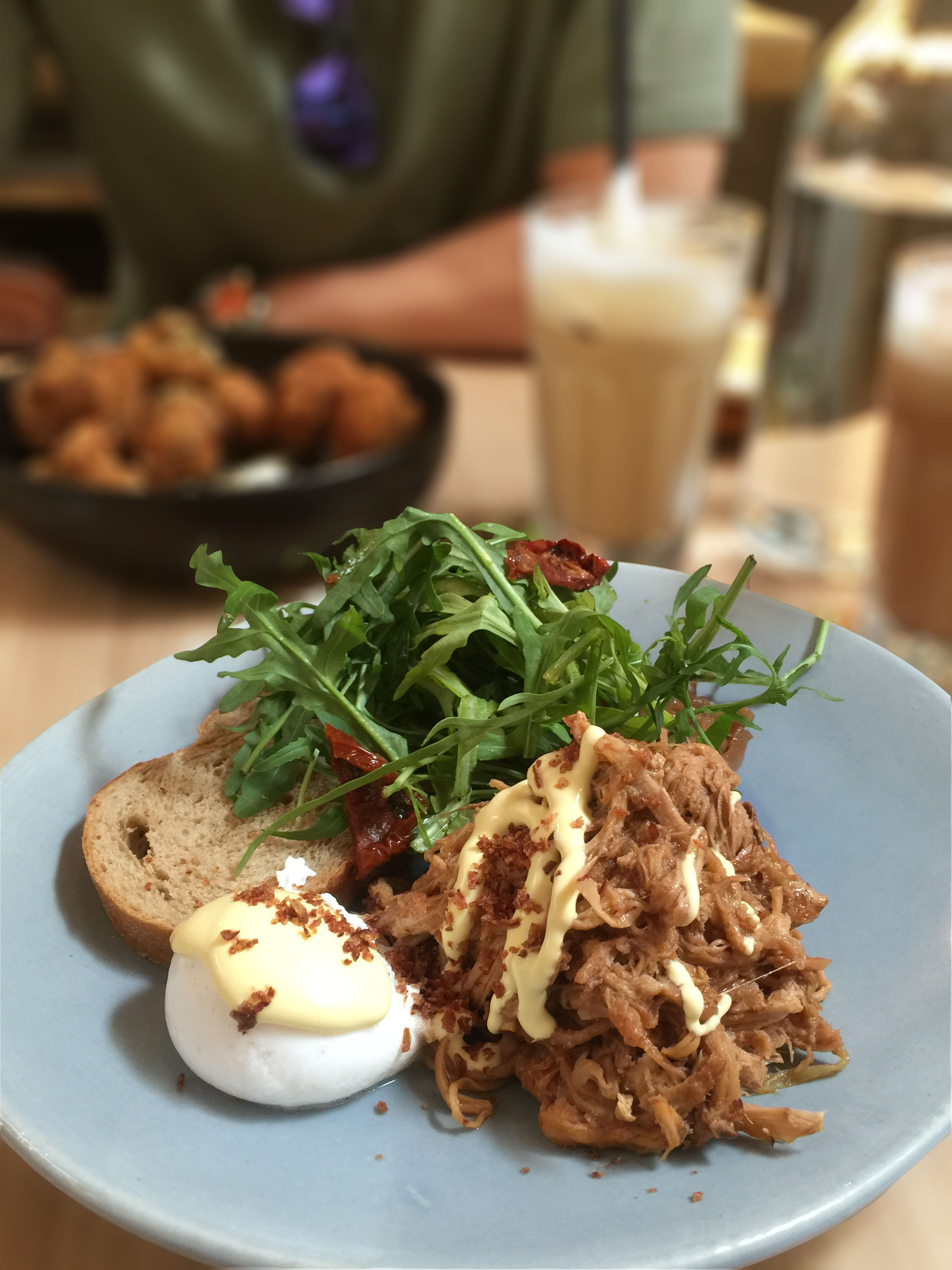 Pulled Pork on Sourdough  coupled with Poached Egg & Hollandaise Sauce with Purple Cabbage & Arugula