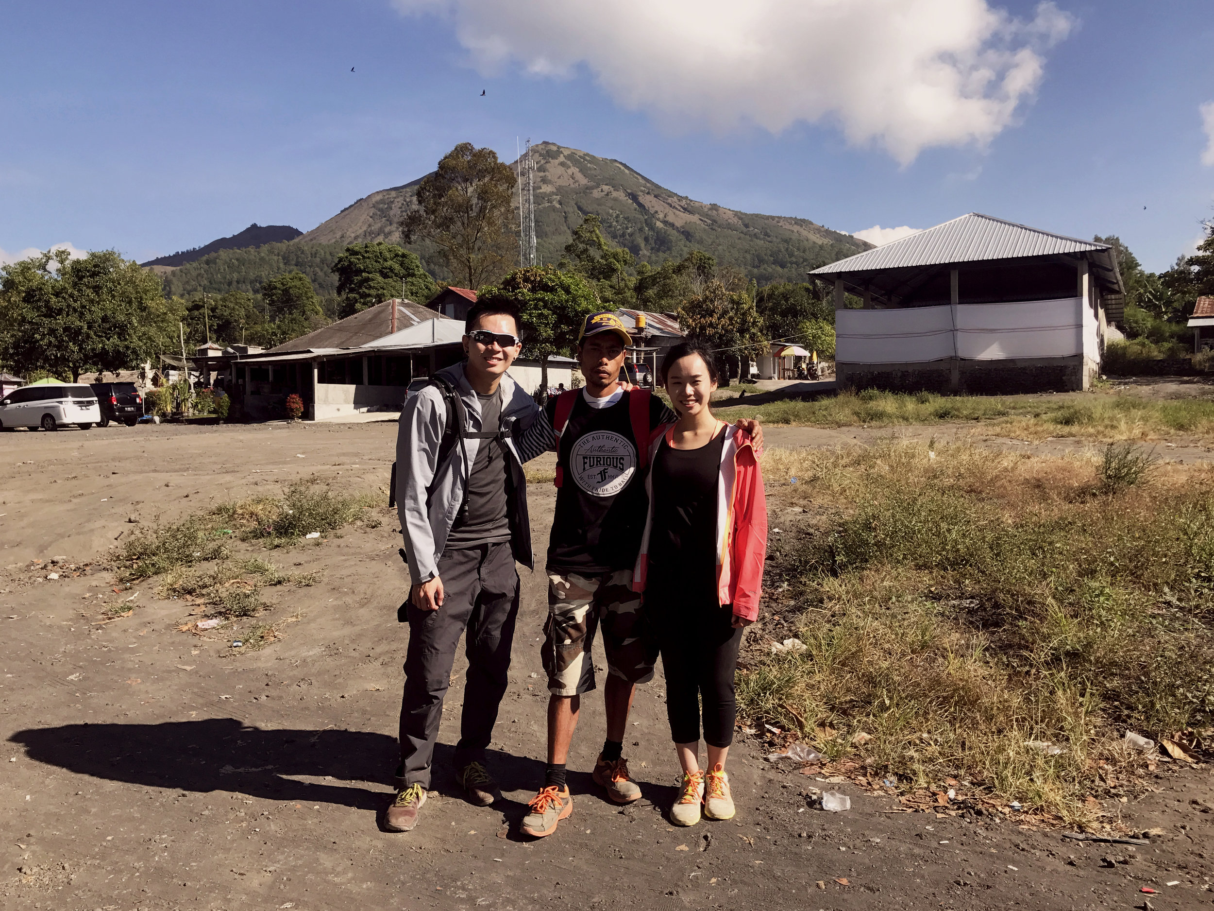 With our guide, Ricky at the base of Mount Batur at the end of our tour.