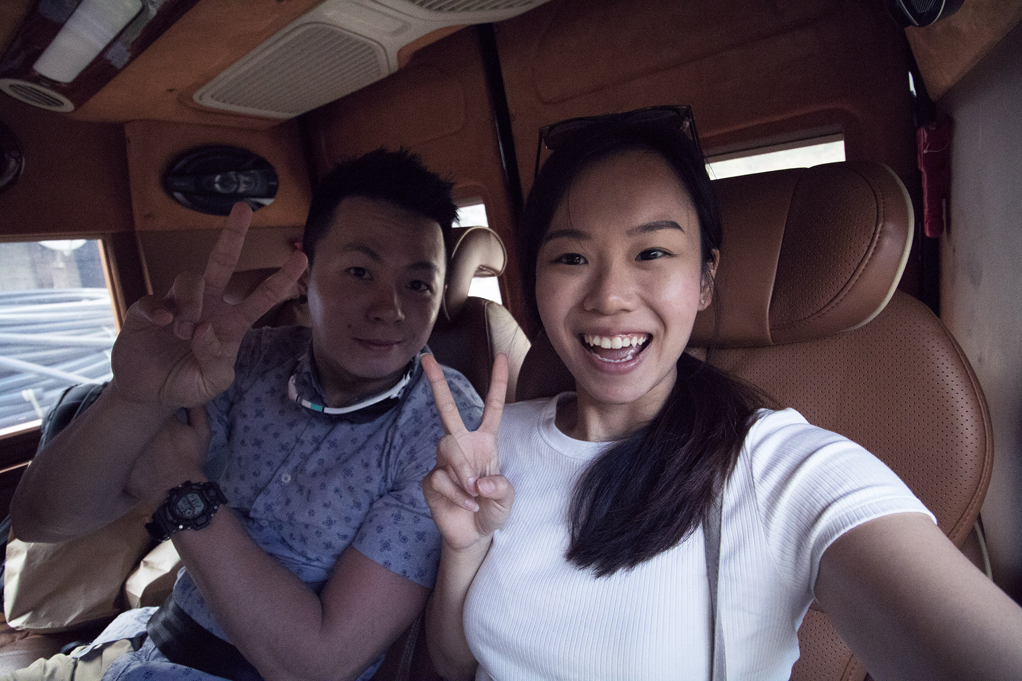 Here's a picture of us in the very comfortable ride!! Ps: I made him do that peace sign with me, haha.