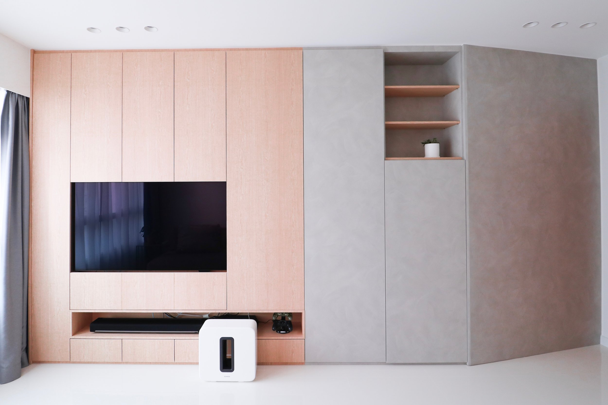 Wide angle view of the living area; Full width built in cabinet + feature wall