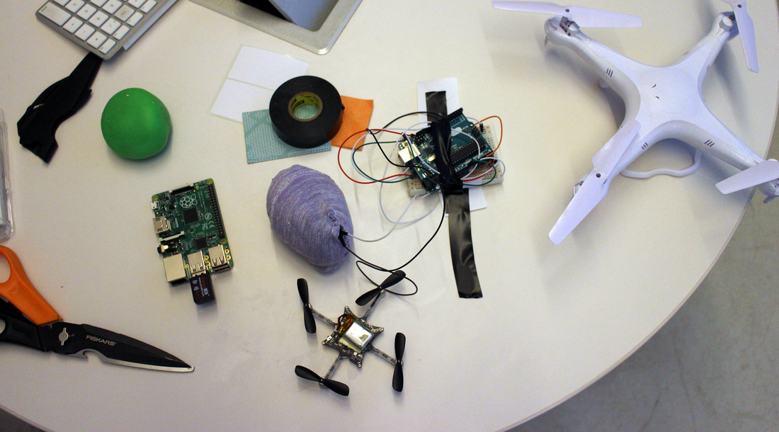 These are the components needed to create the connection for a new controller for the  drone. The raspberry pi holds software and a radio connection,    the Arduino  works as the sensor input controller which controls  the drone's movement, the sensor input is a presser sensor which controls the thrust of the drone, and the LSM9DS0   board controls the  X roll , Y pitch, and Z for yaw.