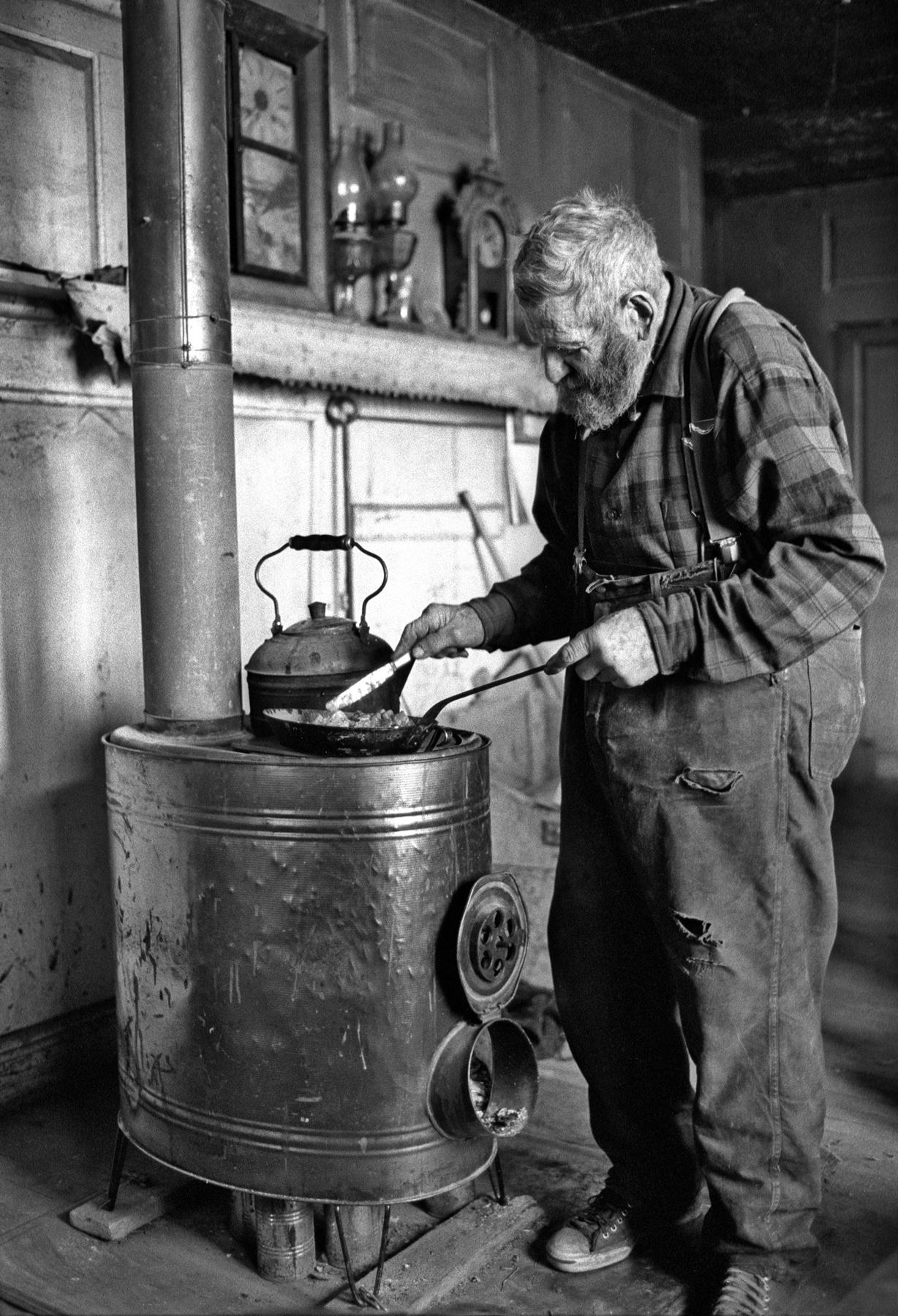 Theron cooking Vt. Folk Life .jpg