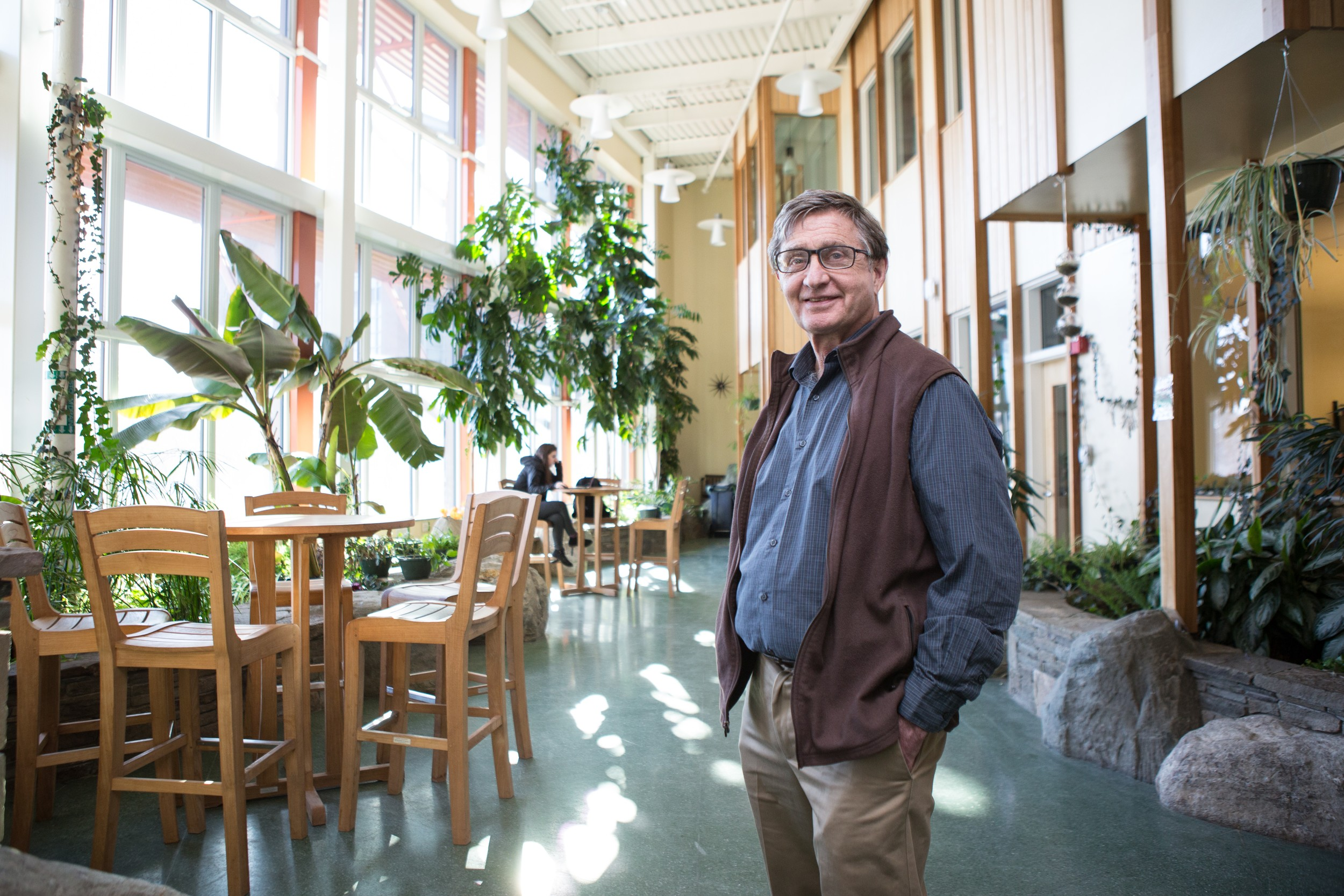 Bill Maclay pictured in the solarium of the George D. Aiken Center–home to the Rubenstein School of Environment and Natural Resources at the University of Vermont–and now a LEED Platinum green building after a 2012 renovation by Maclay's firm, Maclay Architects.