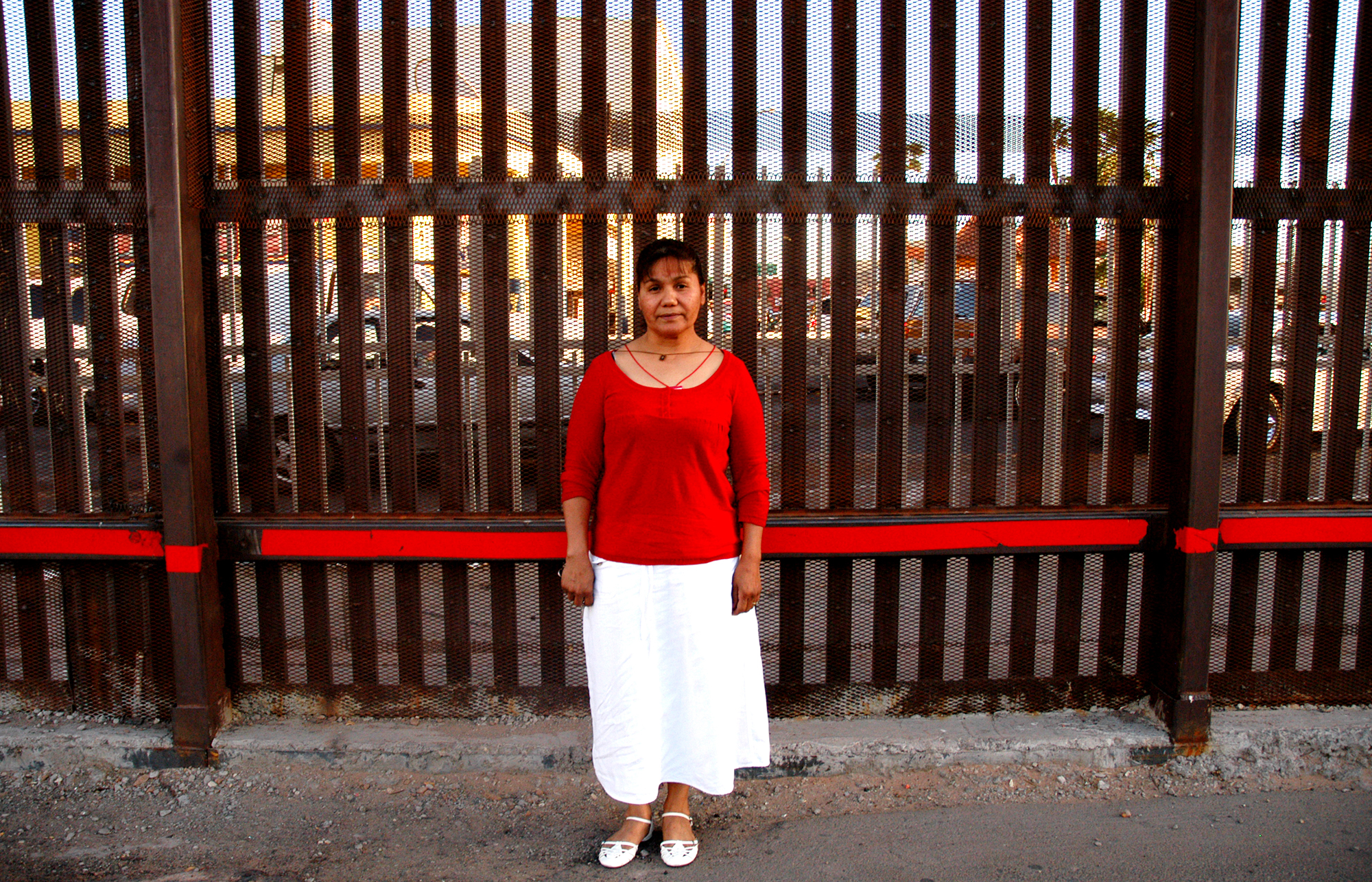 """Alma Valencia, who lives in Calexico, California, but grew up in Mexicali, Mexico, and crosses the border several times a week for church and work. She says """"I like life in Mexico, it's freer, more about community. You go out in the evenings and you see people."""""""