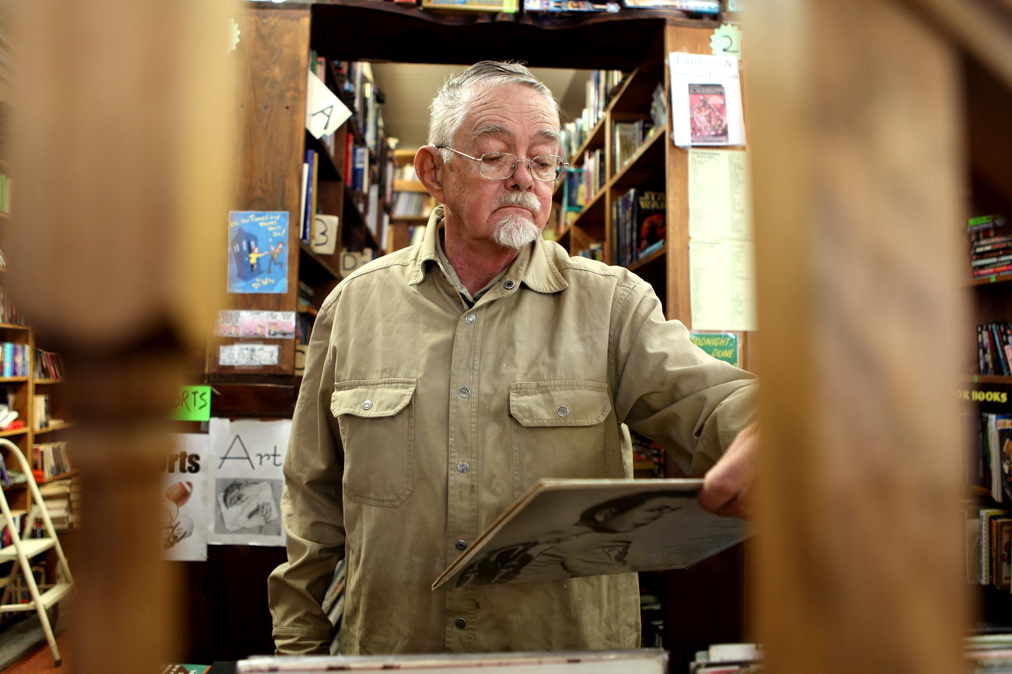 Browsing, at the Corner-Stone Bookshop, Plattsburgh, New York.